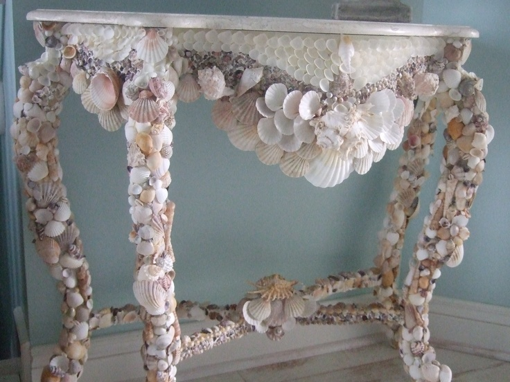 a beautiful console table covered with seashells and mother of pearl is a beautiful piece to rock