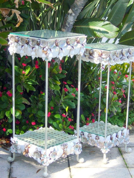 mini glass serving tables clad with seashells look lovely, bold and unexpected and finish any beach home