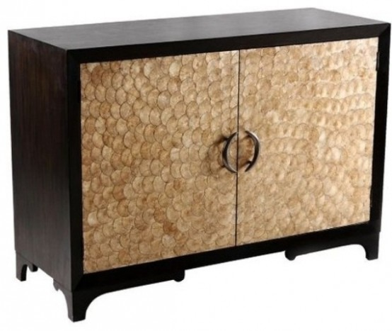 a refined dark stained credenza clad with mother of pearl looks unusual, bold and very cool