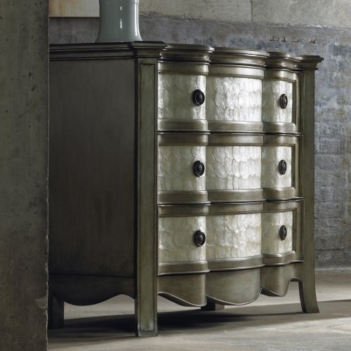 a refined metallic sideboard clad with mother of pearl looks very sophisticated and very chic