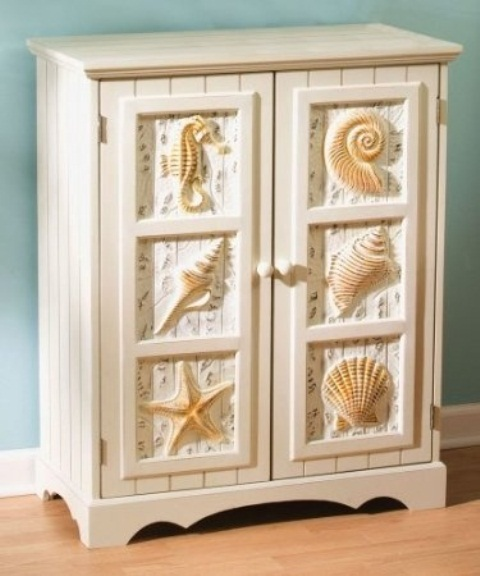a white beadboard cabinet with seashells, seahorses and starfish looks chic and stylish and will accent any coastal space