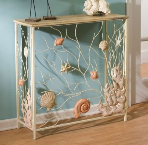 a catchy delicate console table with seashells, starfish and corals in natural colors for a beautiful seaside entryway