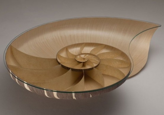 a chic coffee table of plywood and glass inspired by a seashell is a cool solution for a coastal space