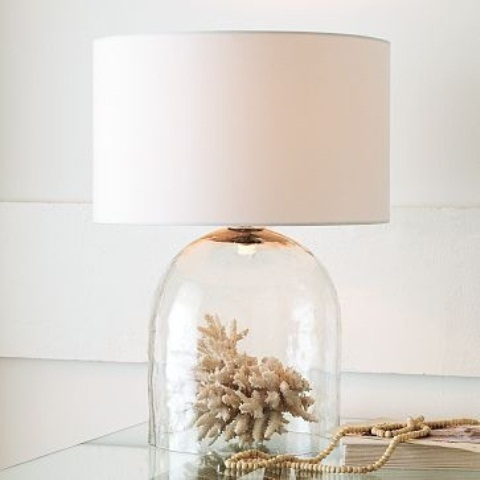 a unique table lamp with a coral in a cloche as a base and a plain lampshade for a seaside space