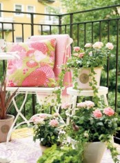 potted blooms and matching blankets and pillows make the balcony fresh, colorful and springy