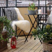 spring bulbs in a bucket and some greenery in baskets around are a cool and fresh way to make your balcony feel like spring