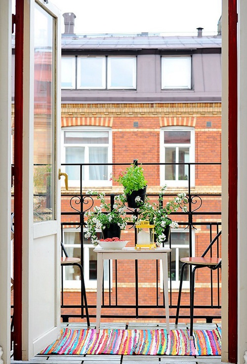 potted greenery and blooms attached to the railing won't take any space and will feel like spring