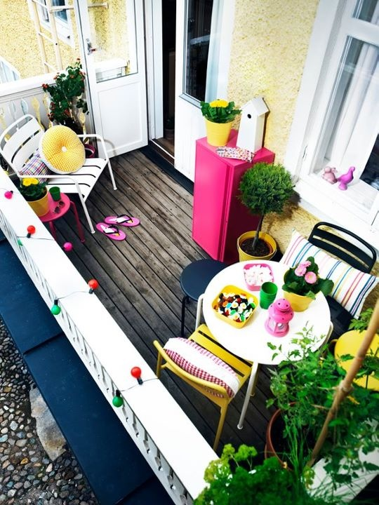 colorful pillows, bright pots with blooms and colorful furniture are amazing for spring and summer in your balcony