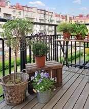 potted greenery and blooms are all you need to turn your balcony into a fresh spring-filled space