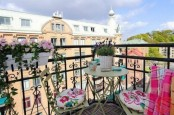 some railing pots with blooms, colorful blankets and floral cushions are nice for refreshing your balcony for spring