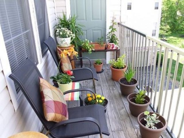 potted greenery and blooms, colorful printed pillows for a fresh spring touch in the balcony