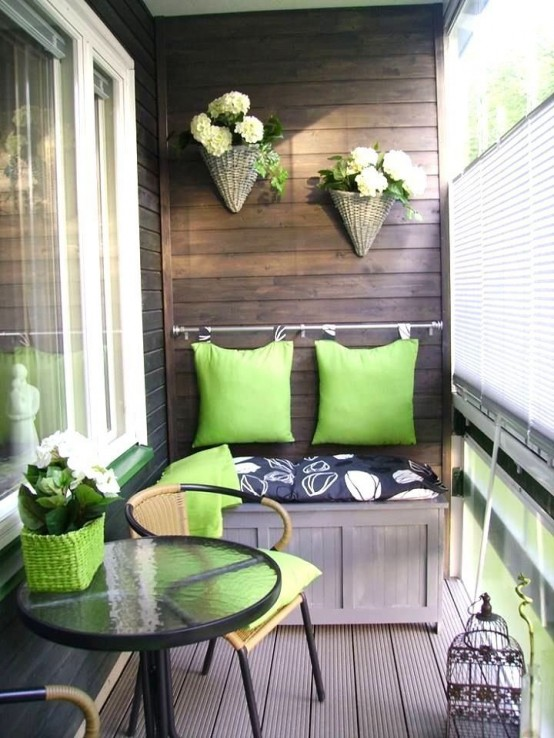 a green wicker pot, matching pillows attached to the wall and wicker planters hanging on it