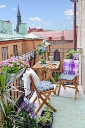 colorful blooms and greenery in pots, brigth pillows and blankets are amazing for refreshing your balcony