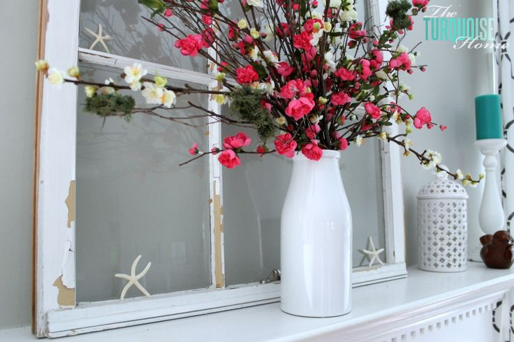 a summer mantel with bright blooms, a vintage window, starfish and turquoise candles