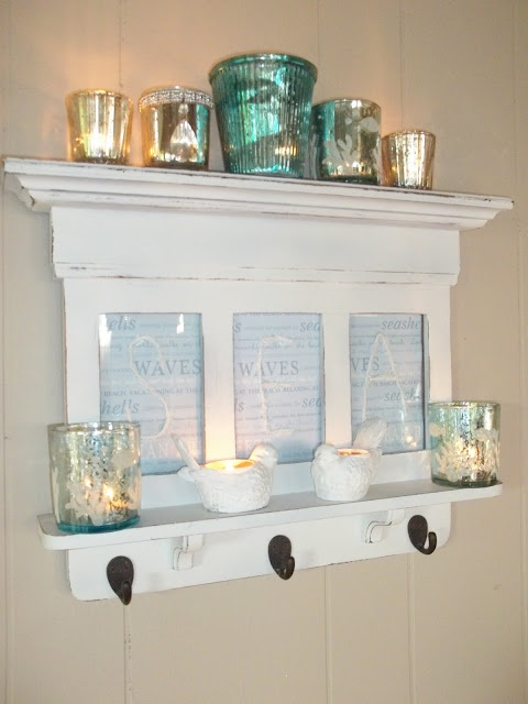a faux beachy mantel with candle lanterns, signs, corals will add to the space
