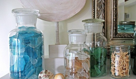 style your summer mantel with jars filled with starfish, seashells and sea glass of various colors