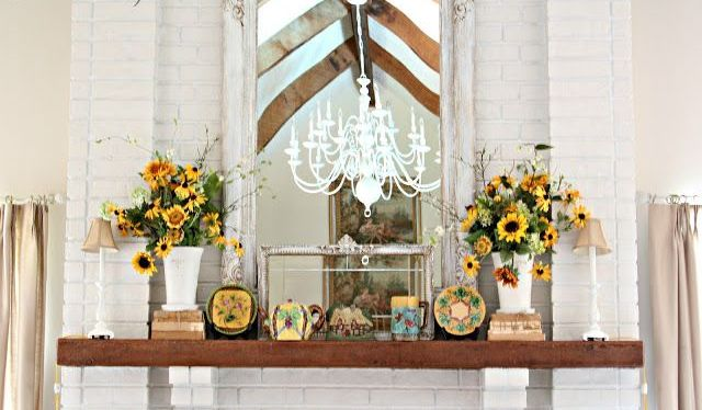 a rustic summer mantel with burlap lamps, vintage books, sunflowers and vintage teaware