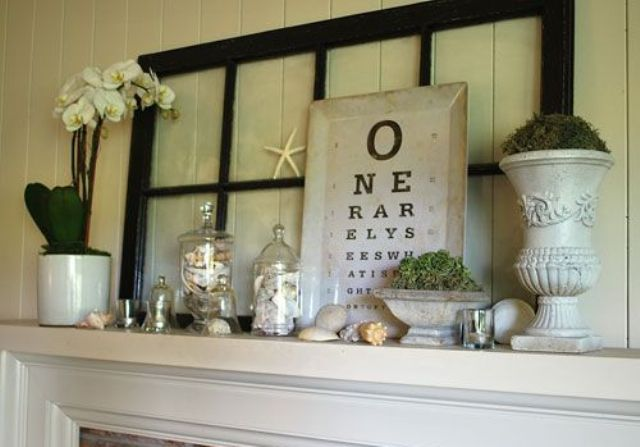 an eclectic summer mantel with blooms, greenery, shells in jars, starfish and other stuff