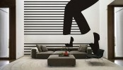 a monochromatic living room in contemporary space, a black graphic wall mural that makes a statement in the space