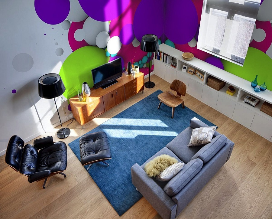 colorful and bright wall murals on the walls make the neutral living room extra bold and very eye catchy