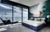 a contemporary beachy bedroom with a full view and a gorgeous surfing wall mural that helps to emmbrace the location