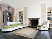 a contemporary refined living room with an antique city wall mural that visually expands the space making it eye-catching