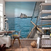 a contemporary home office with a large sea and ship wall mural that inspires and reminds of oceans and beaches