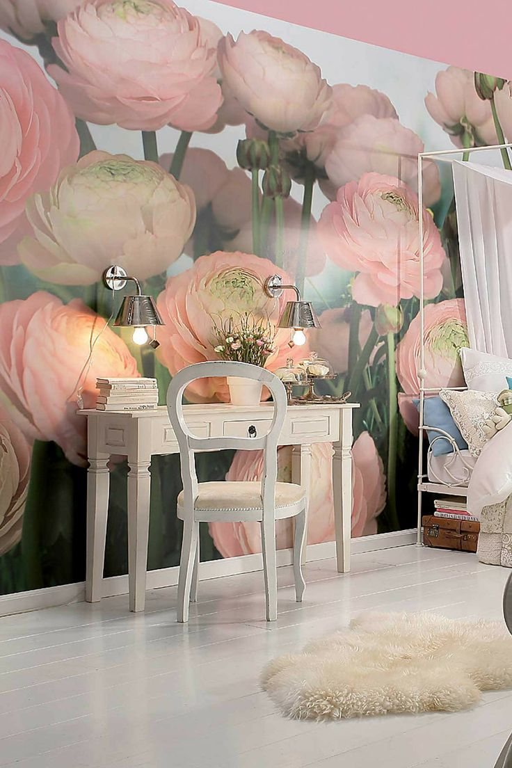 a girlish bedroom and home office with a large natural pink ranunculus wall mural that takes over the whole space