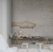 a simple and contemporary space done in neutrals with a catchy wall mural – a textural wall with a brick touch