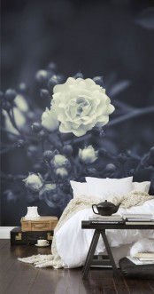 a monochromatic bedroom with a black and white floral wall mural that is elegant, chic and takes over the whole bedroom