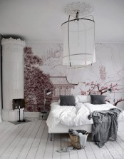 a catchy Nordic bedroom done in mostly white, with a pink Japanese wall mural with sakura and a temple that changes the whole room