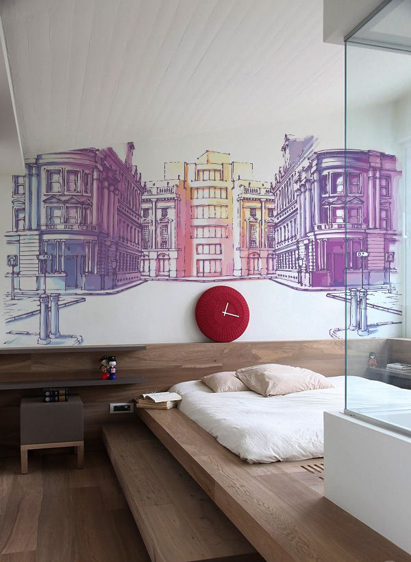 a contemporary bedroom with a colorful city wall mural that makes a statement and brings color to the space