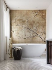 a neutral bathroom with a catchy sakura wall mural that brigns romance and chic to the space