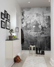 a neutral contemporary entryway with a catchy black and white graphic wall mural that brings a bold and catchy look