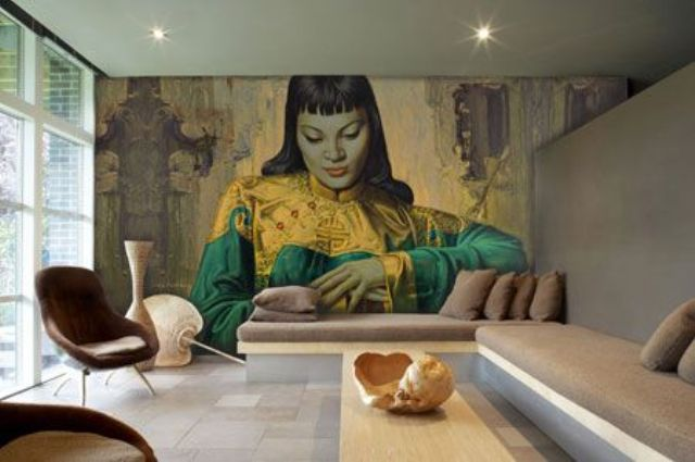 a contemporary living room with a bold and catchy woman wall mural in bright shades