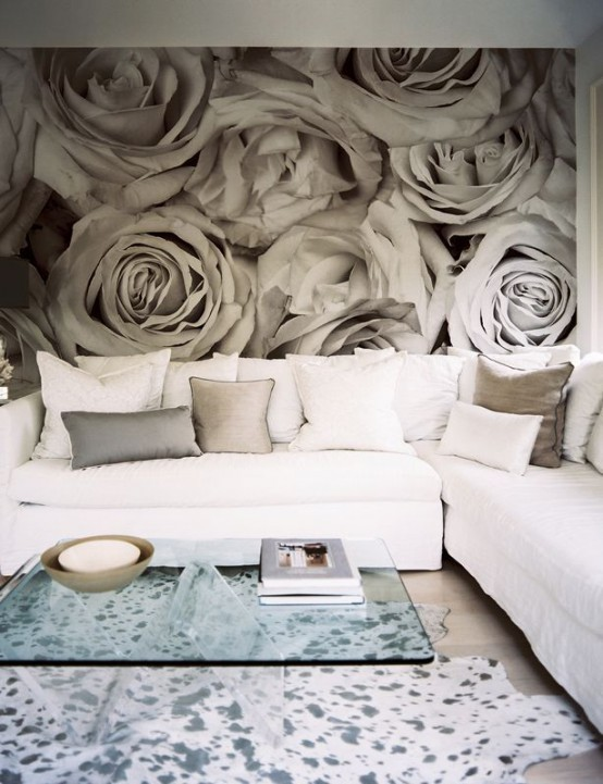 a contemporary living room with a neutral floral wall mural for eye-catchiness and a romantic touch in the space
