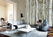 a neutral and stylish living room with a birch wall mural is a stylish space with a touch of outdoors