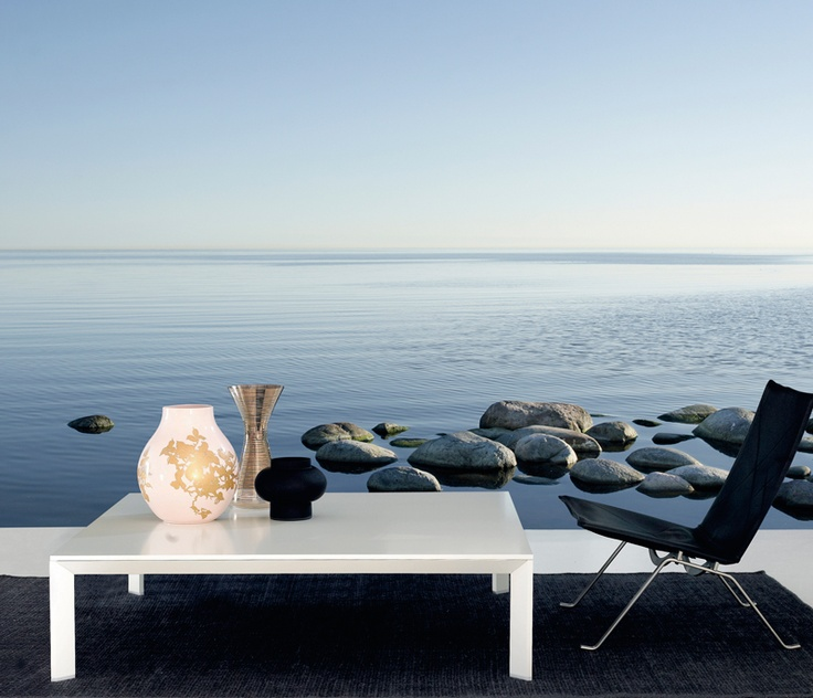 a contemporary nook with black and white furniture and a coastal wall mural that helps you relax and enjoy every moment