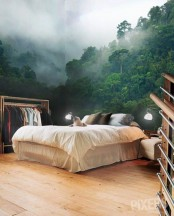a contemporary bedroom done with a gorgeous nature wall mural that makes it feel like it's a tropical space