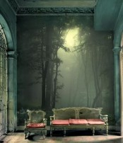 a refined space with chic furniture and a moody woodland wall mural that creates an ambience