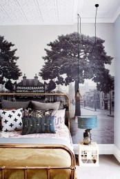 a black and white wall mural opposes the bold and bright furniture in the room and this combo looks cool