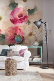 a bright living room with a colorful floral wall mural and bright furniture and lamps for a welcoming feel