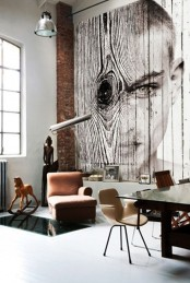 a contemporary space with a unique wood-imitating and portrait wall mural that catches an eye