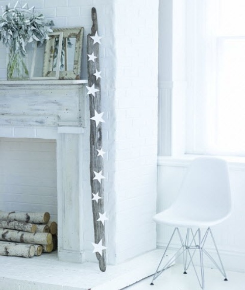 a non-working fireplace clad with whitewashed wood and brick plus firewood inside is a romantic and lovely idea