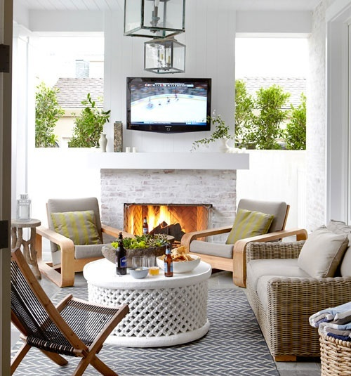 a whitewashed brick fireplace in a terrace will make your outdoor living room very cozy and very welcoming