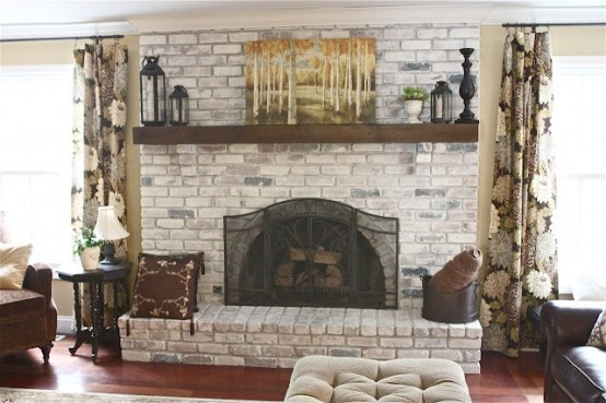 a whitewashed brick fireplace with a mantel, candle lanterns, an artwork will bring coziness to the space