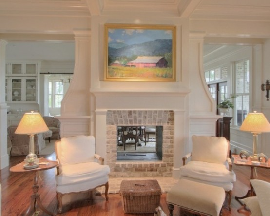 an elegant living room with a white non-working fireplace with a whitewashed brick part looks chic and brings coziness