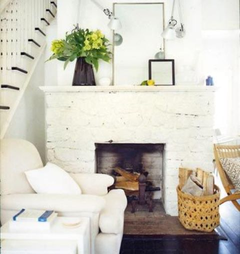 a whitewashed stone non-working fireplace will bring coziness to the space and elegance at the same time