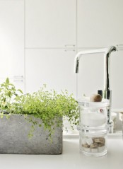 a concrete planter with greenery will be a nice idea for any bathroom, it's veyr durable and very stylish and will add a contemporary touch to the space