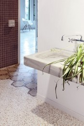 potted greenery will refresh a minimalist bathroom and it's especially cool on a concrete sink here